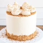 This Biscoff Cake pairs fluffy vanilla cake layers with a sweet cookie butter frosting and crushed speculoos cookies. | livforcake.com
