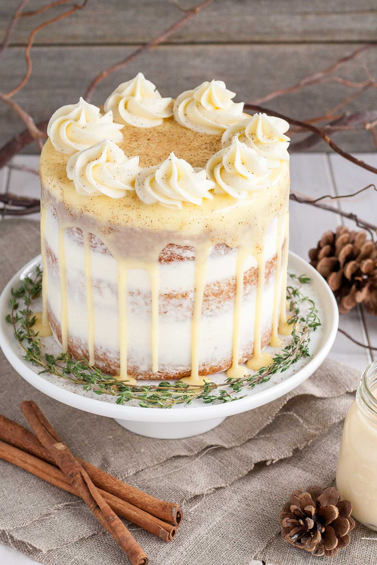 Eggnog cake with rum simple syrup and cream cheese frosting.