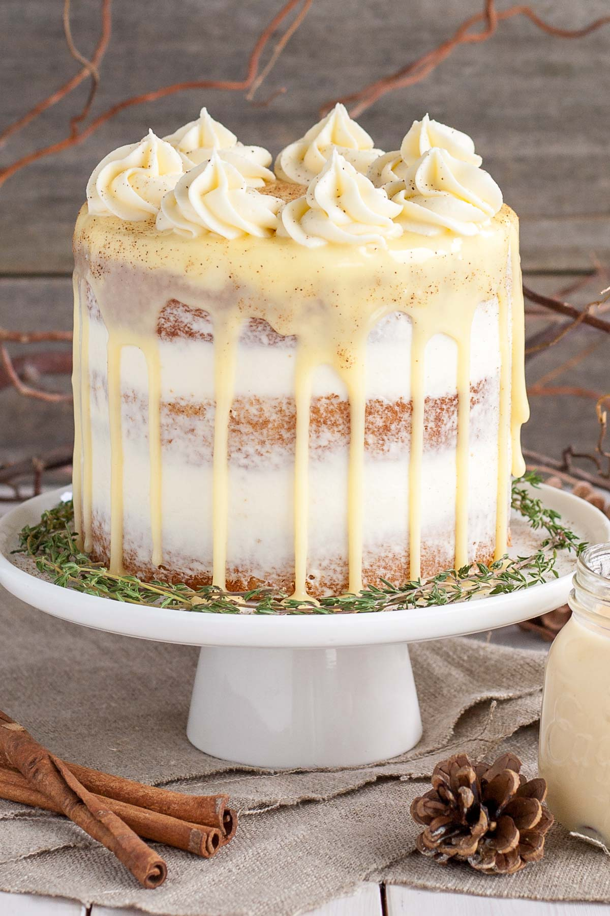 Eggnog cake with cream cheese frosting and white chocolate ganache.
