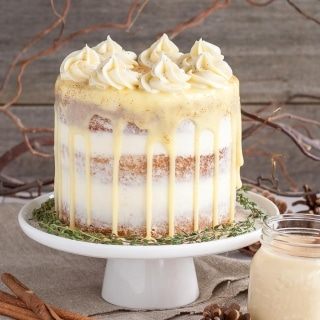 This rum spiked Eggnog Cake with cream cheese frosting and white chocolate ganache is just the thing to warm you up this Holiday season!   livforcake.com