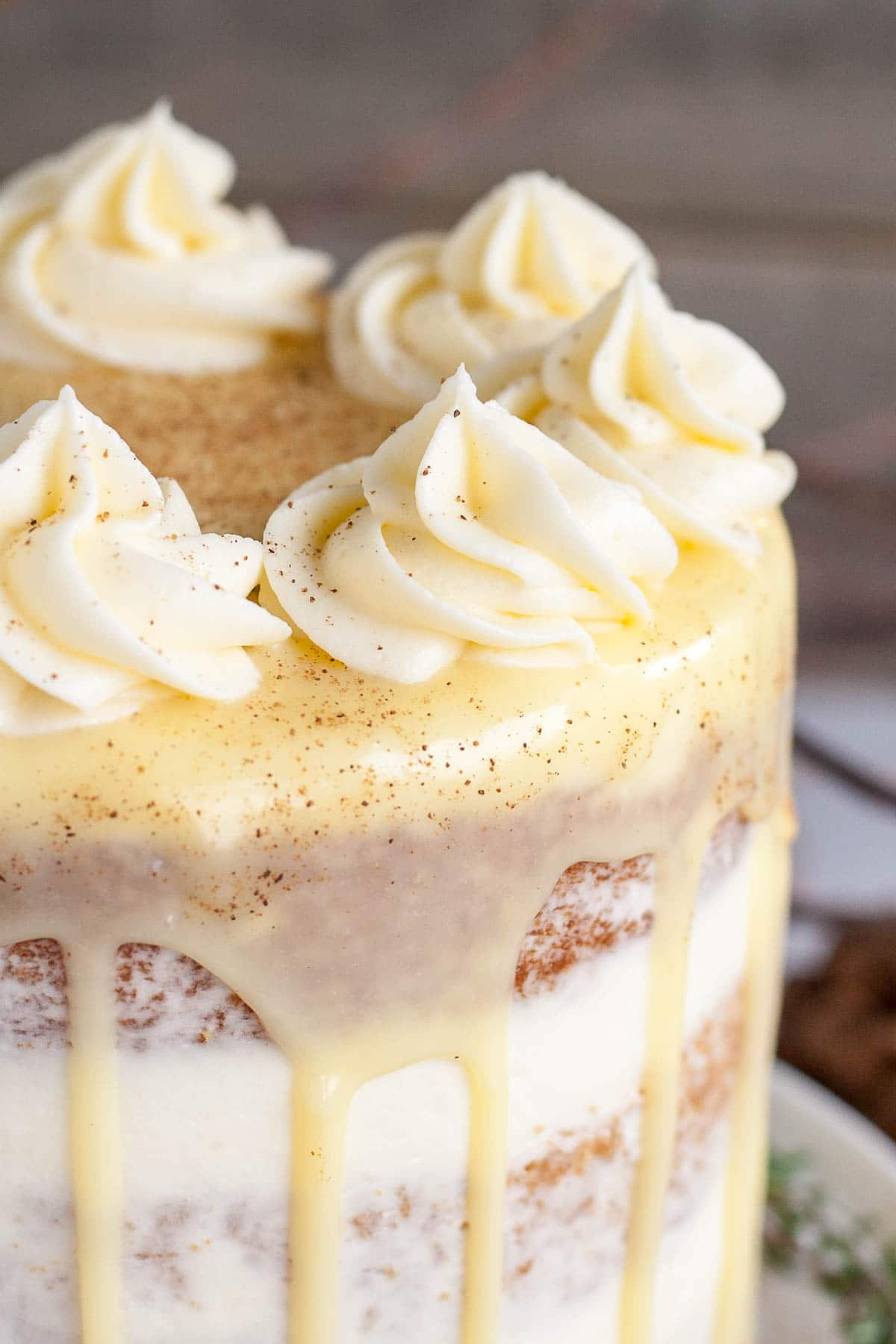 Close up of rosettes on an eggnog cake.