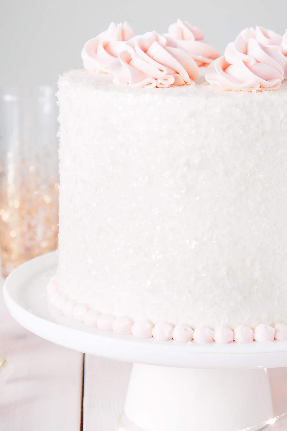 Close up of cake sparkles on a pink champagne cake.