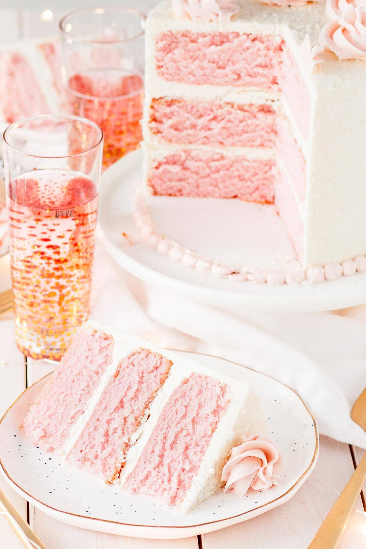 Three layers of Pink Champagne Cake with vanilla swiss meringue buttercream.
