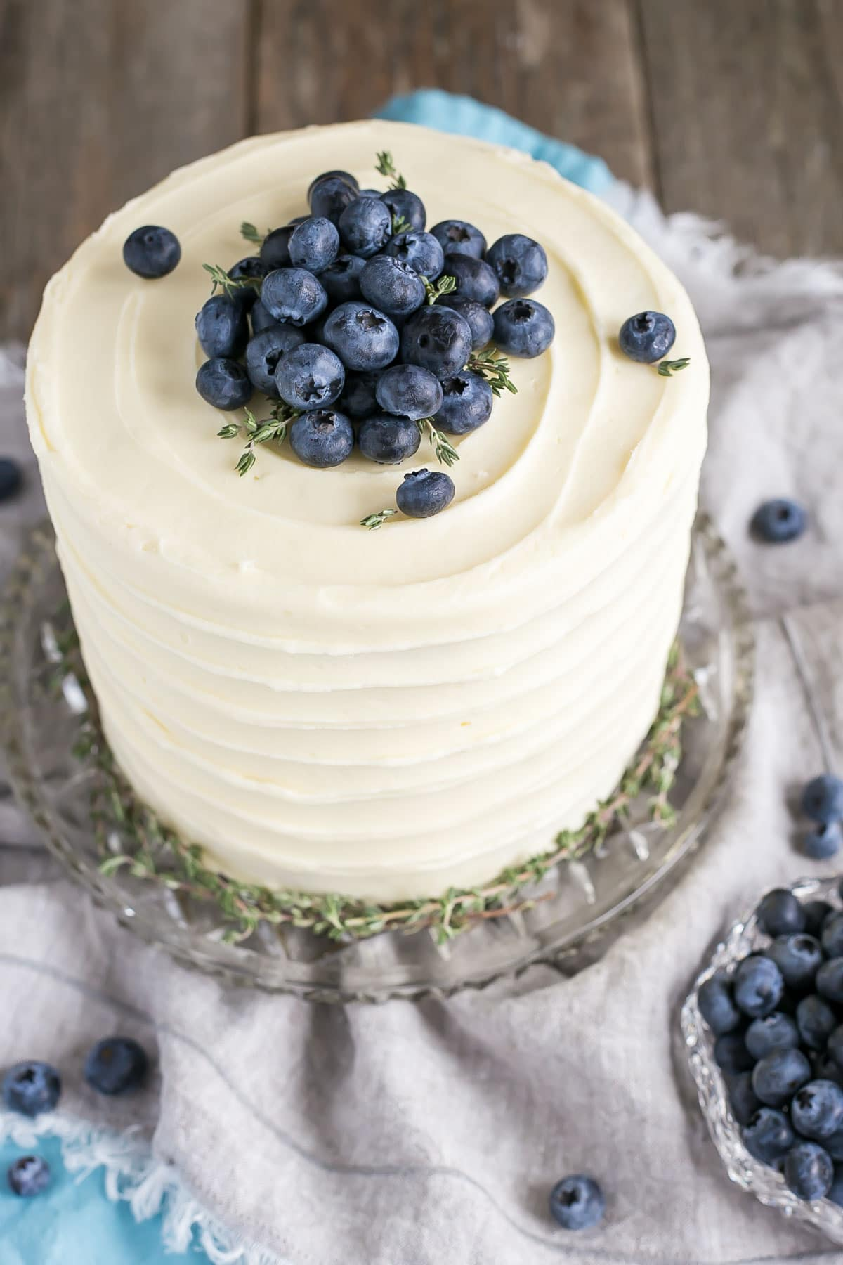 Easy banana cake recipe with blueberries and cream cheese frosting.