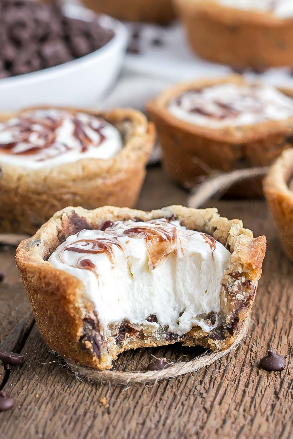 These chewy Chocolate Chip Cookie Cups are truly one of the easiest desserts you'll ever make. Filled with Vanilla Cream Cheese Mousse and a swirl of chocolate sauce. | livforcake.com