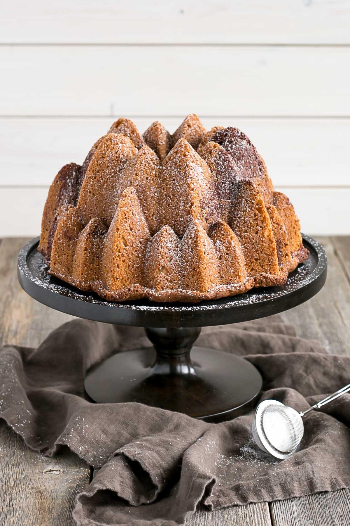 Bundt cake on a dark cake stand.