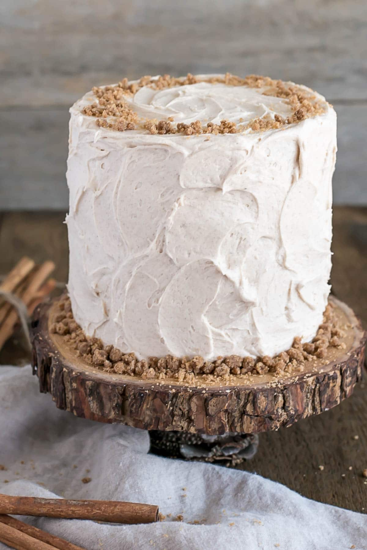 Spice Cake on top of a rustic wooden cake stand.