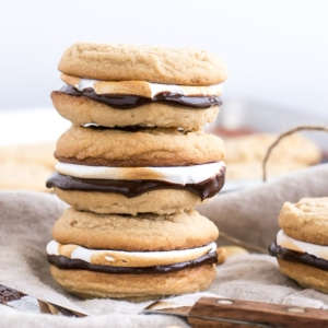 Three sandwiched cookies stacked, close up.