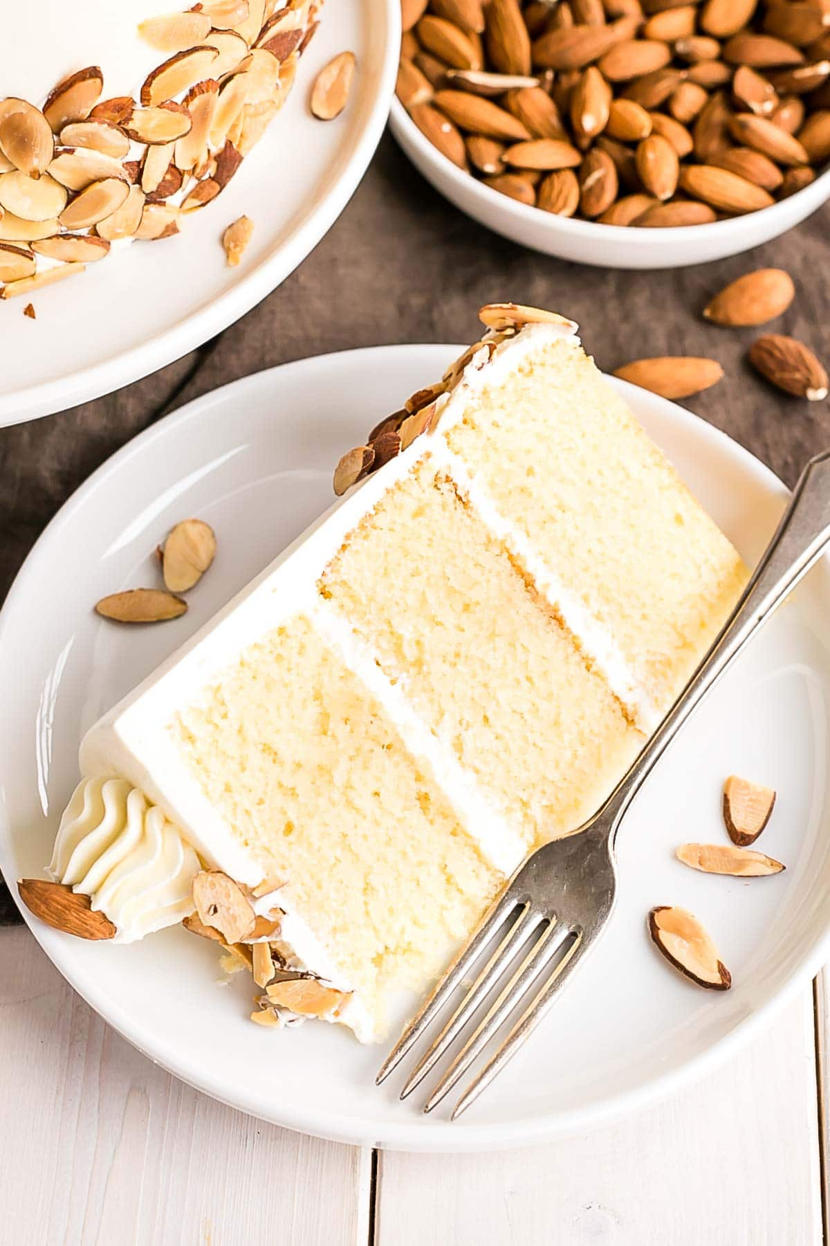 Cut slice of Almond Amaretto Cake.