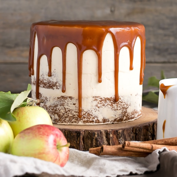 Kick off Apple season with this delicious Caramel Apple Cake! A spice cake made with diced apples, paired with a caramel buttercream, and caramel drizzle. | livforcake.com