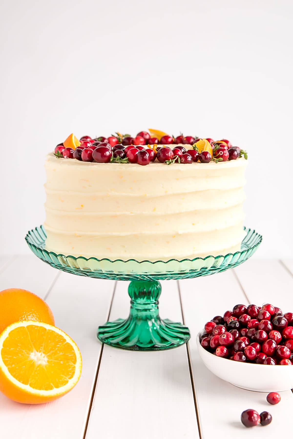 Loaded with fresh cranberries and packed with orange flavour, this Cranberry Orange Cake with cream cheese frosting is a hit for any occasion! livforcake.com