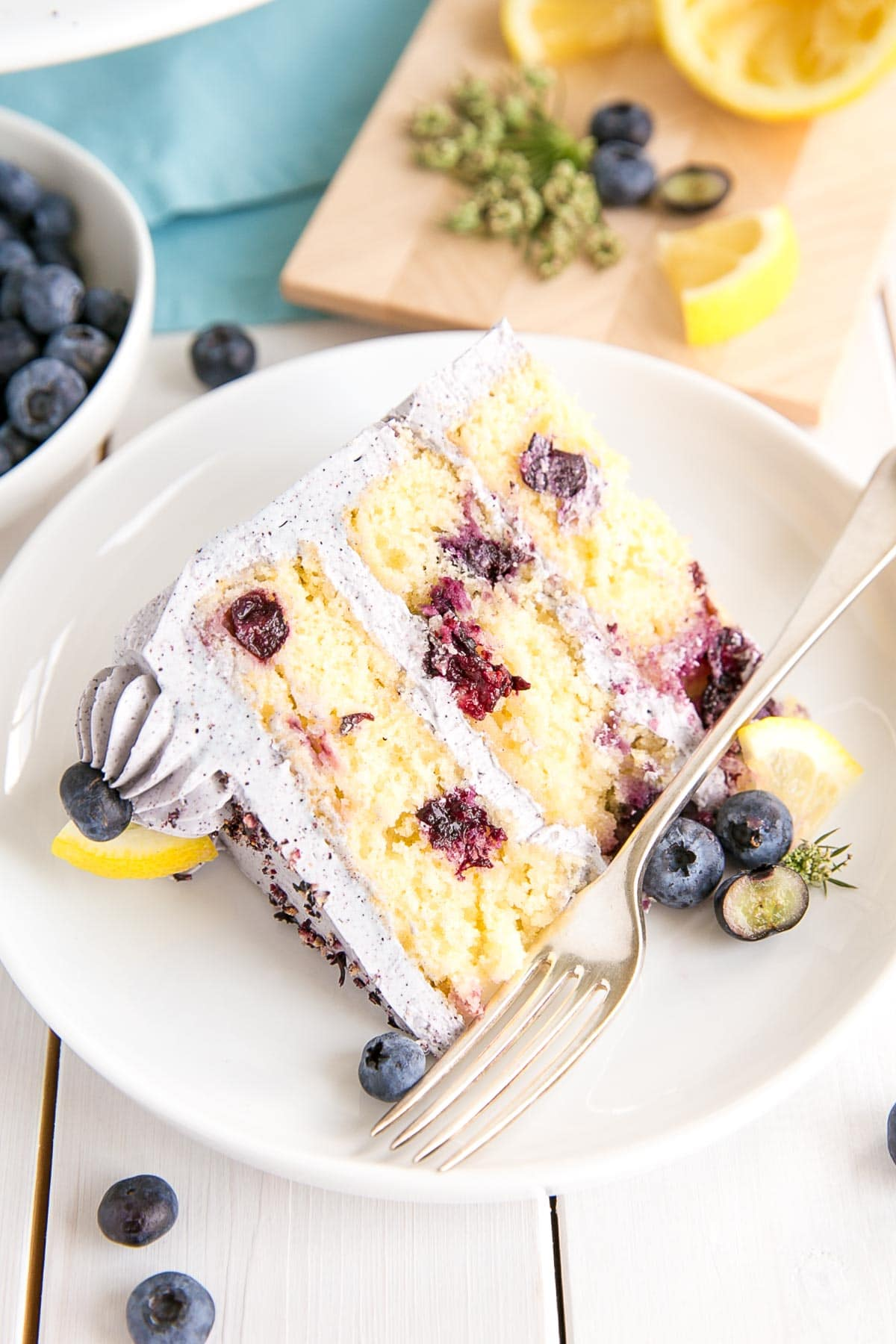 Slice of lemon blueberry cake with blueberry buttercream