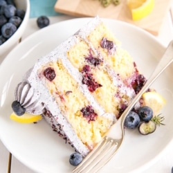 Lemon Blueberry Cake! A moist and delicious lemon cake with fresh blueberries and a blueberry buttercream. | livforcake.com