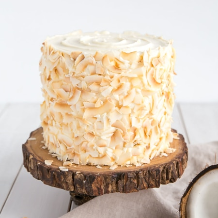 A coconut cake sitting on top of a table