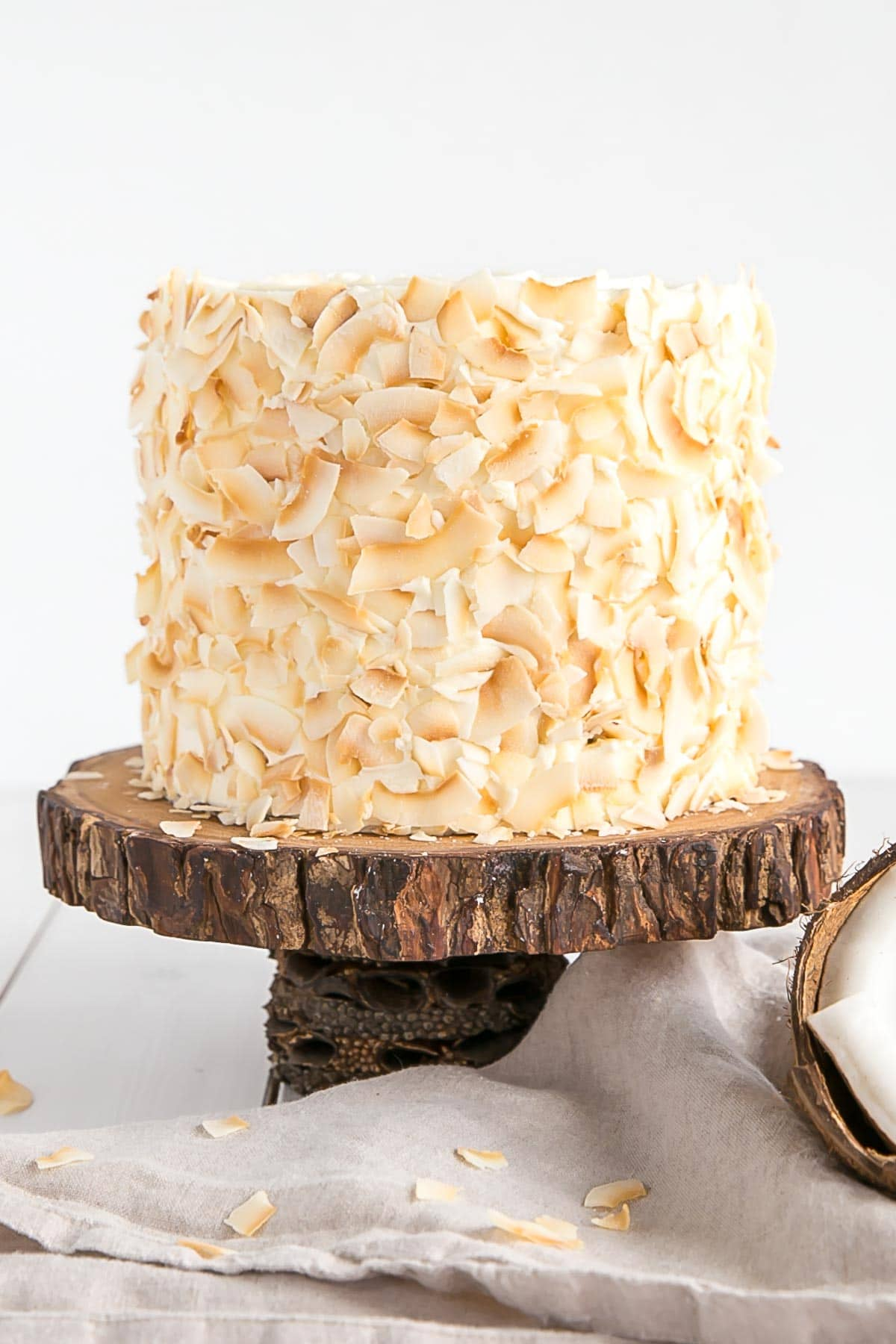 Coconut cake with toasted coconut flakes.