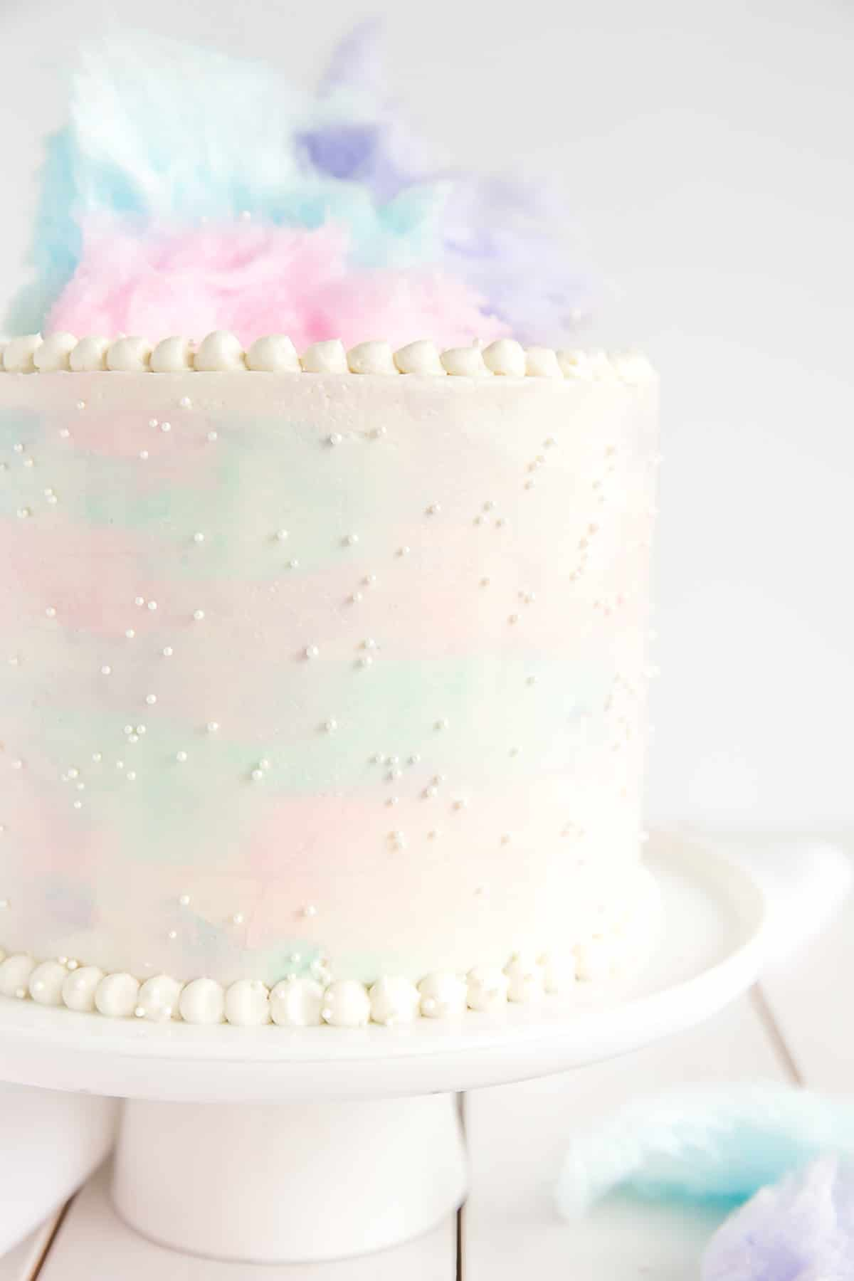 Close Up Of Cotton Candy Cake Decorated With A Pearl Border