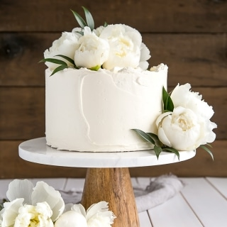 This Lemon Elderflower Cake is my copycat version of the royal wedding cake! Elderflower infused lemon cake layers with lemon curd and elderflower buttercream. | livforcake.com