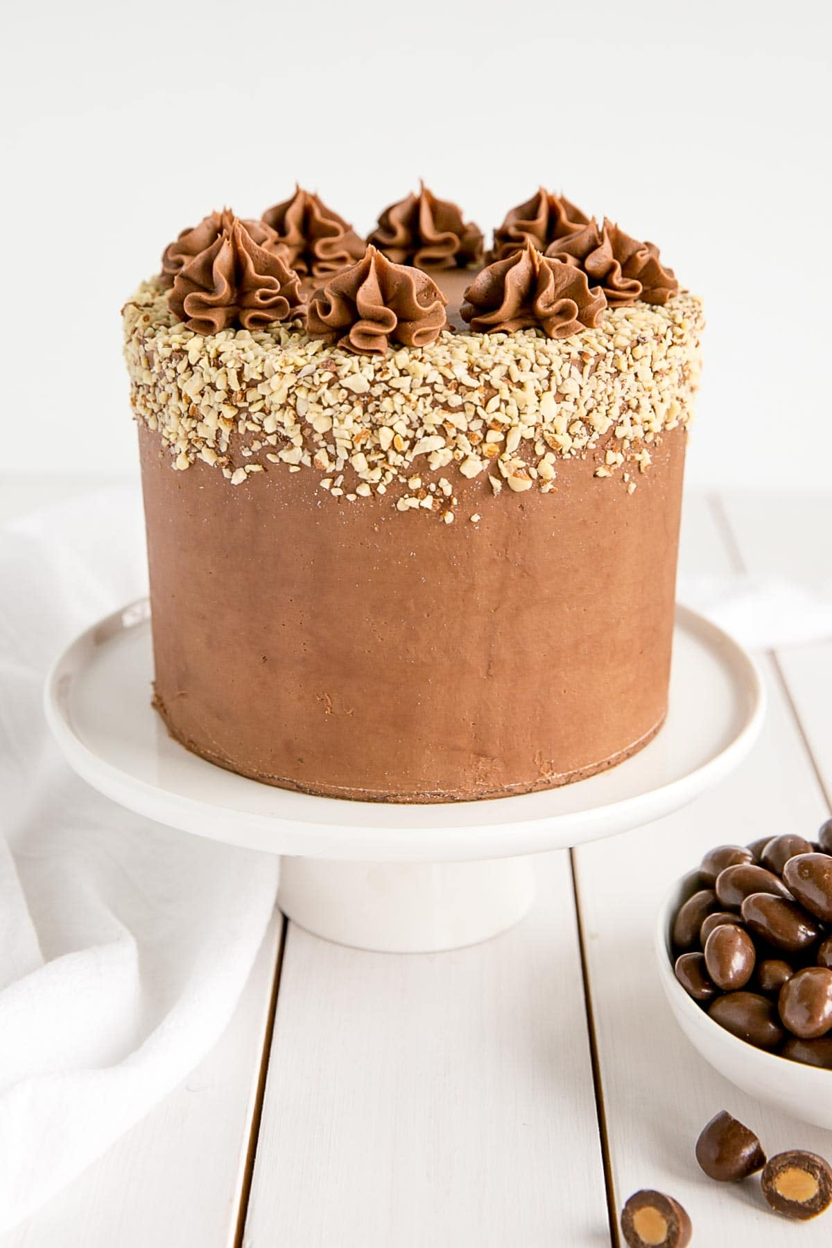 Almond cake layers with a milk chocolate ganache.