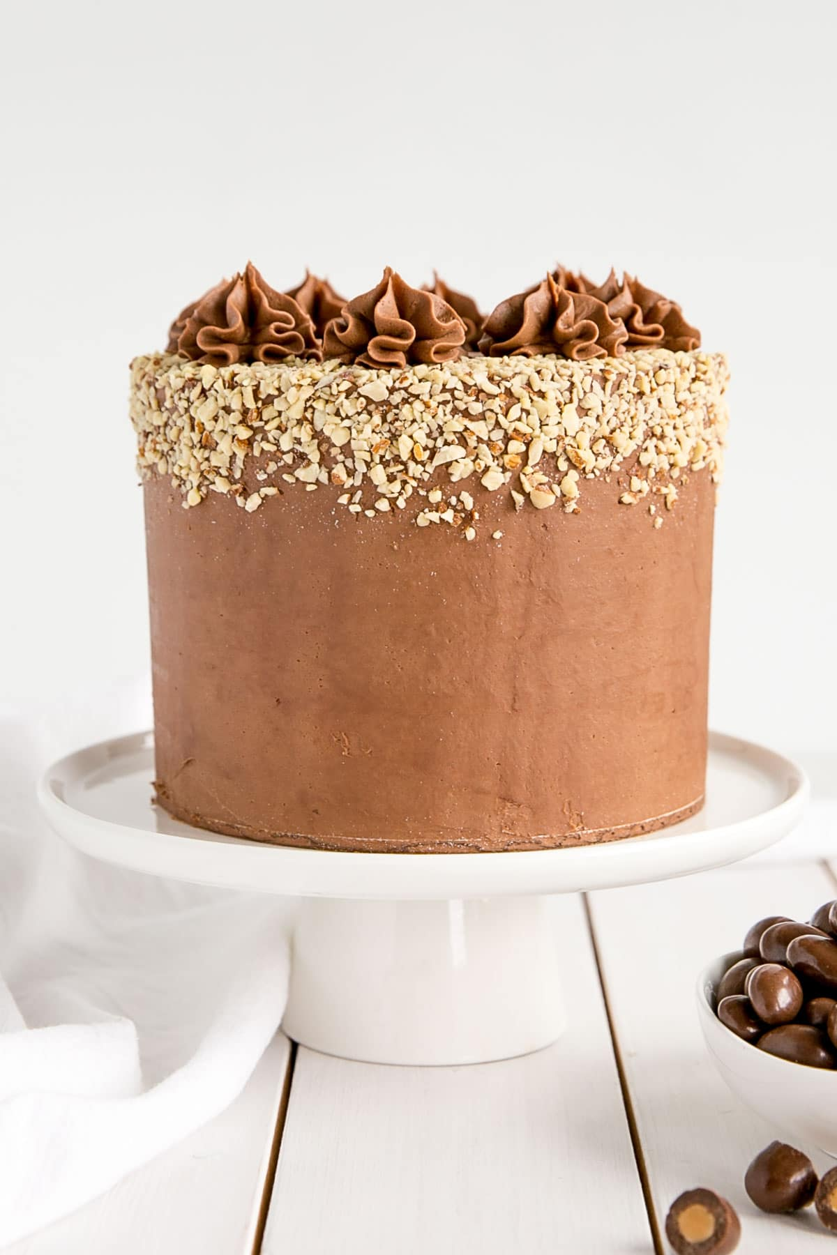 Milk Chocolate Almond Cake! Fluffy almond cake layers with a milk chocolate ganache.