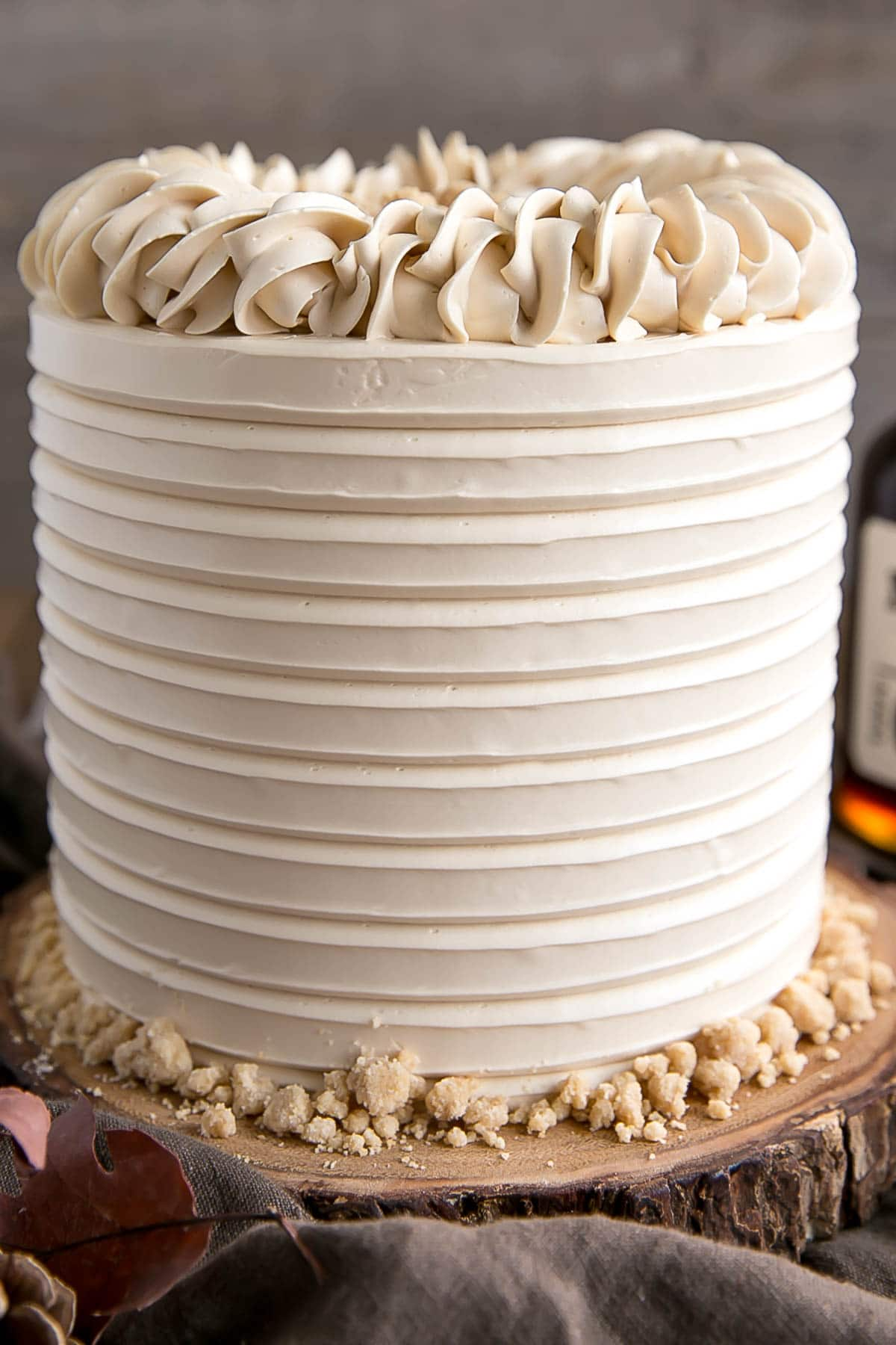 Close up of Maple Cake showing textured frosting and rope border.