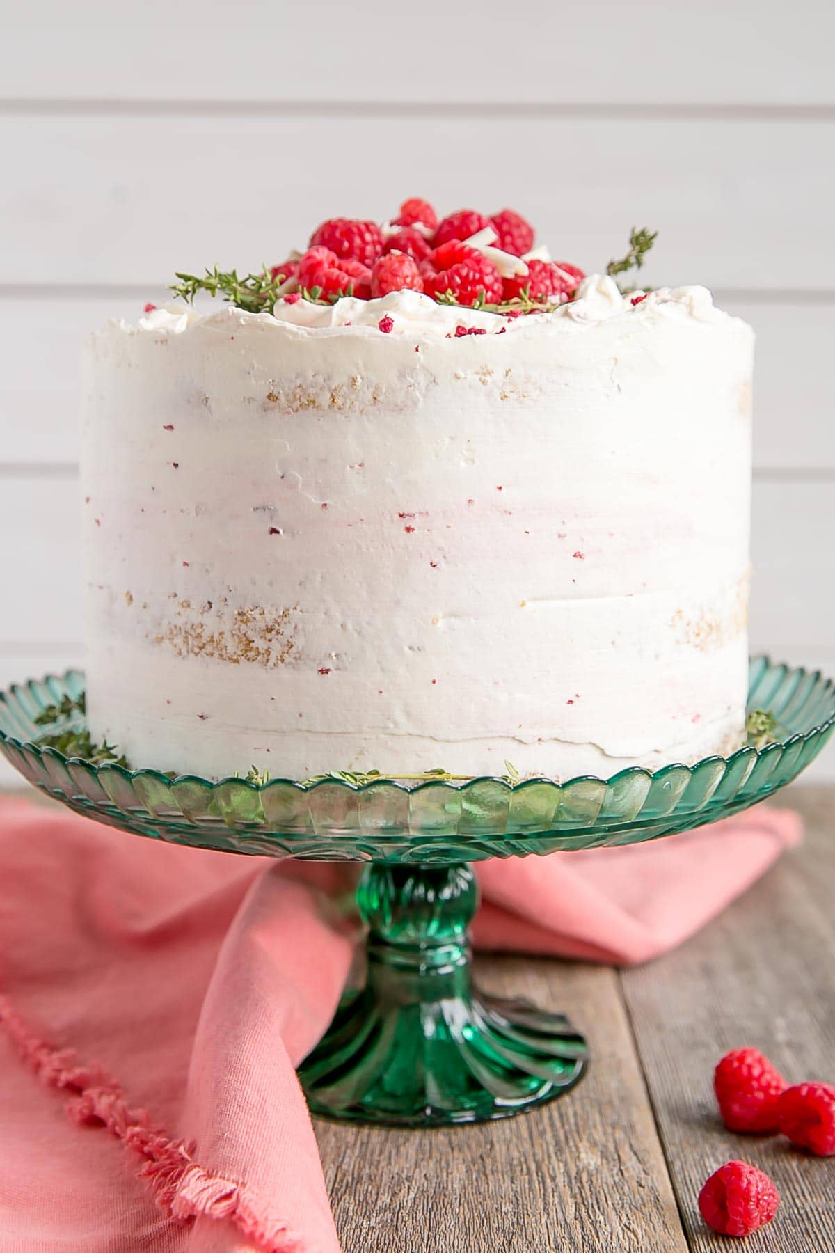 White chocolate cake with fresh raspberries and raspberry jam.