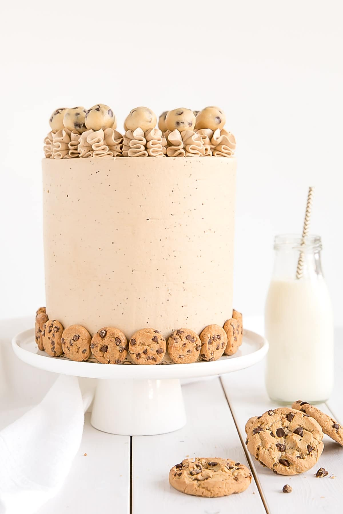 A cookie lovers dream! Chocolate Chip Cookie Cake with cookie dough filling and cookie frosting.