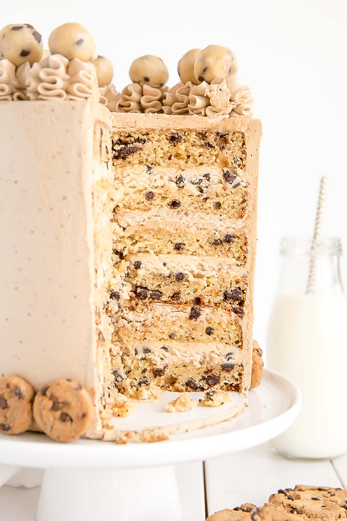Six layer Chocolate Chip Cookie Cake with brown sugar chocolate chip cake layers, a cookie dough filling, and a chocolate chip cookie frosting!