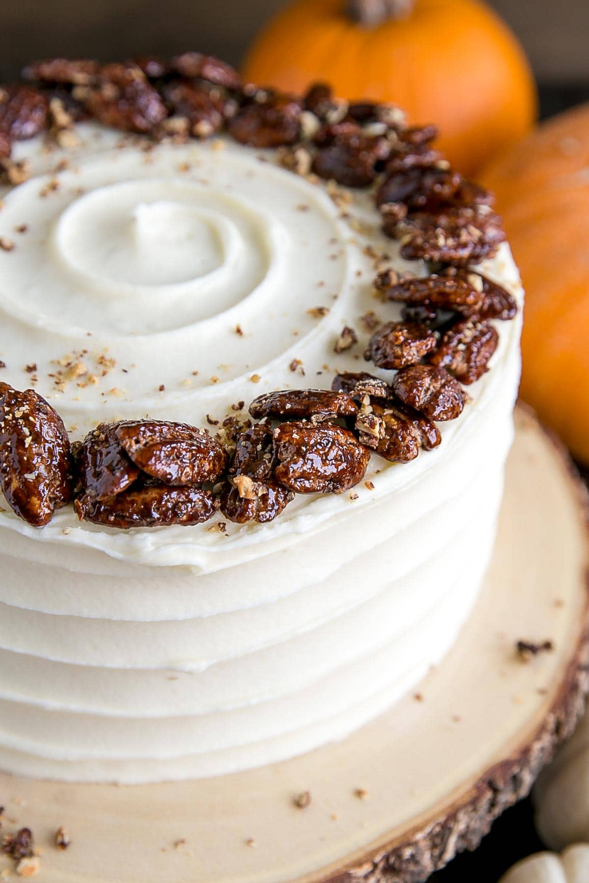 Candied pecans on top of a pumpkin cake
