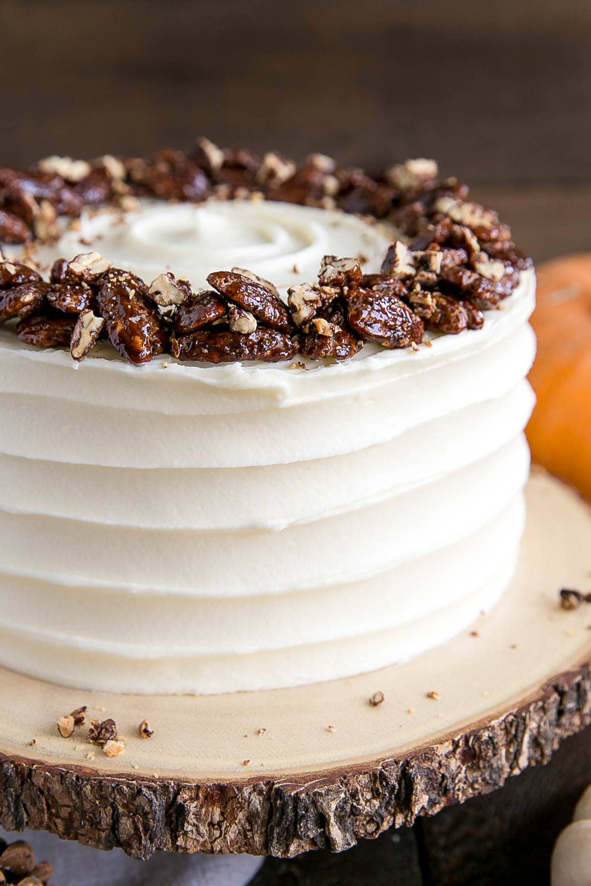 Close up of pumpkin cake with a rustic cream cheese frosting.
