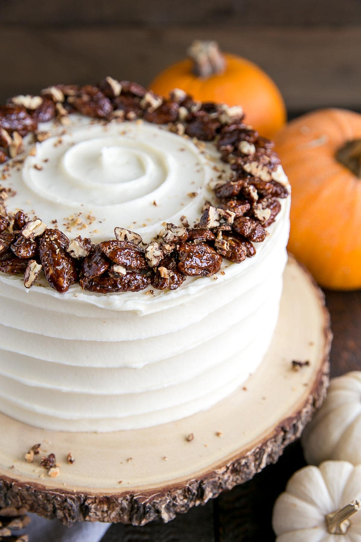 Fall themed pumpkin cake with candied pecans.