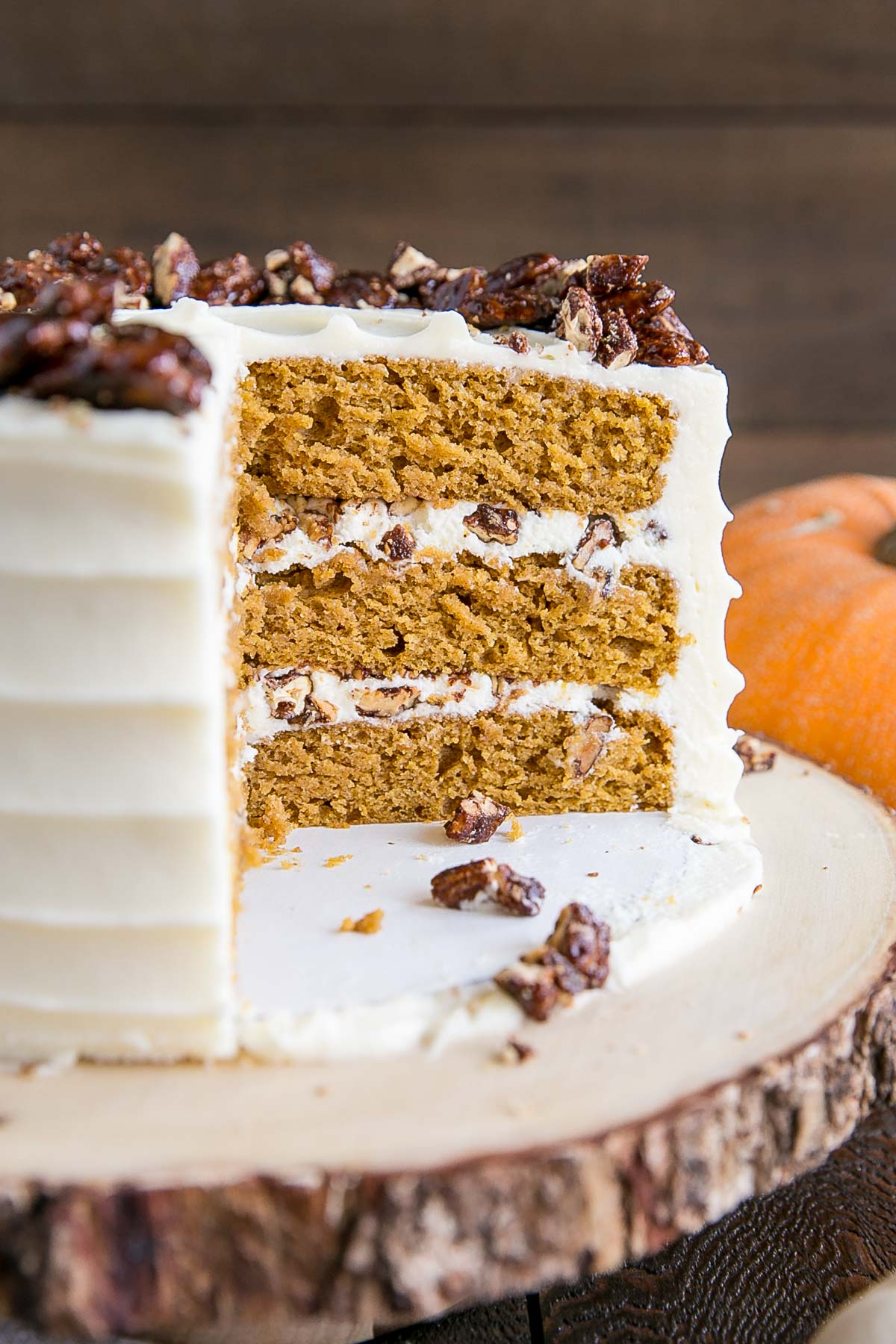 Cross-section of pumpkin cake with candied pecans.