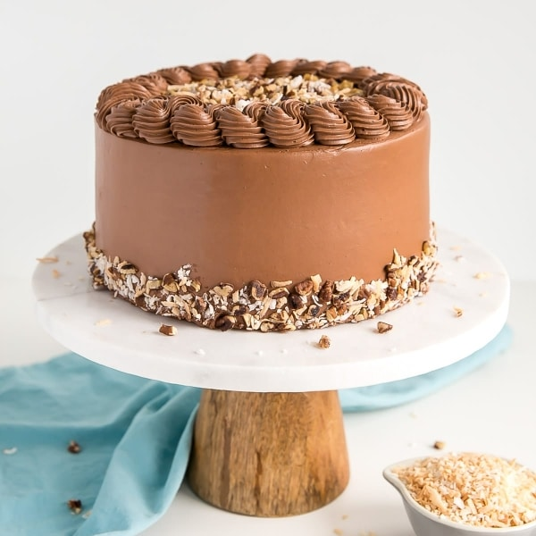 This classic German Chocolate Cake combines rich chocolate cake layers with a sweet coconut pecan filling and a dreamy chocolate buttercream. | livforcake.com