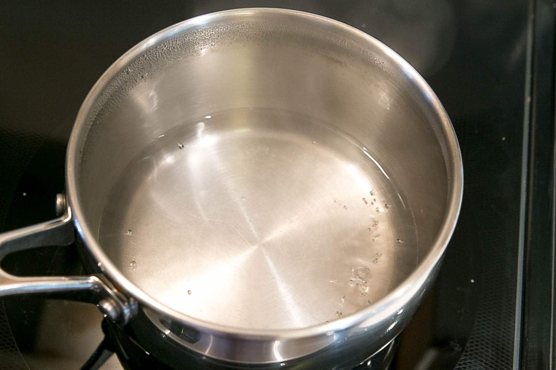 Pot with simmering water.