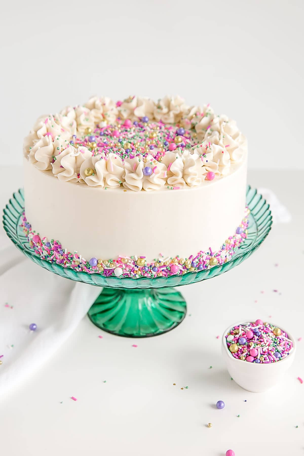 Classic white cake recipe with white swiss meringue buttercream.