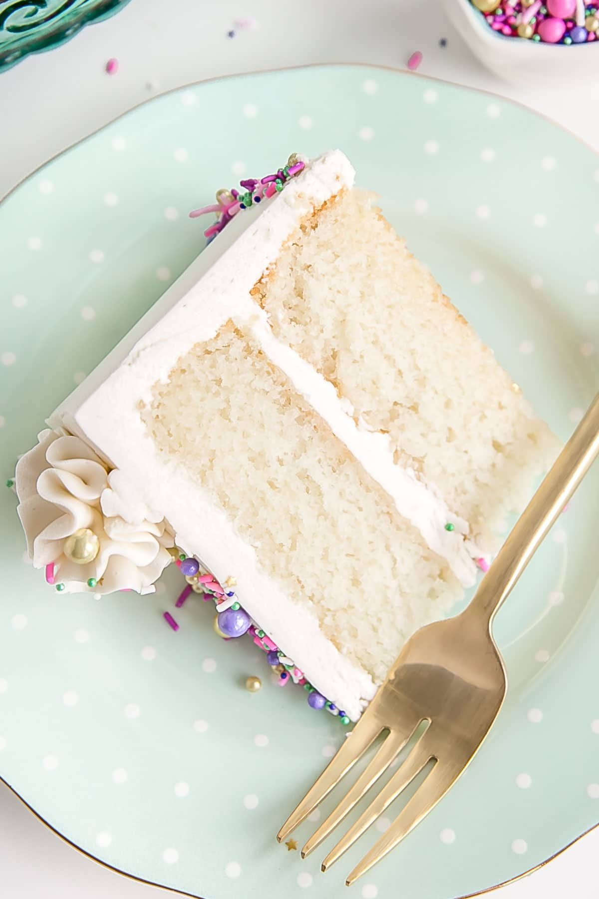 Slice of white cake with white buttercream