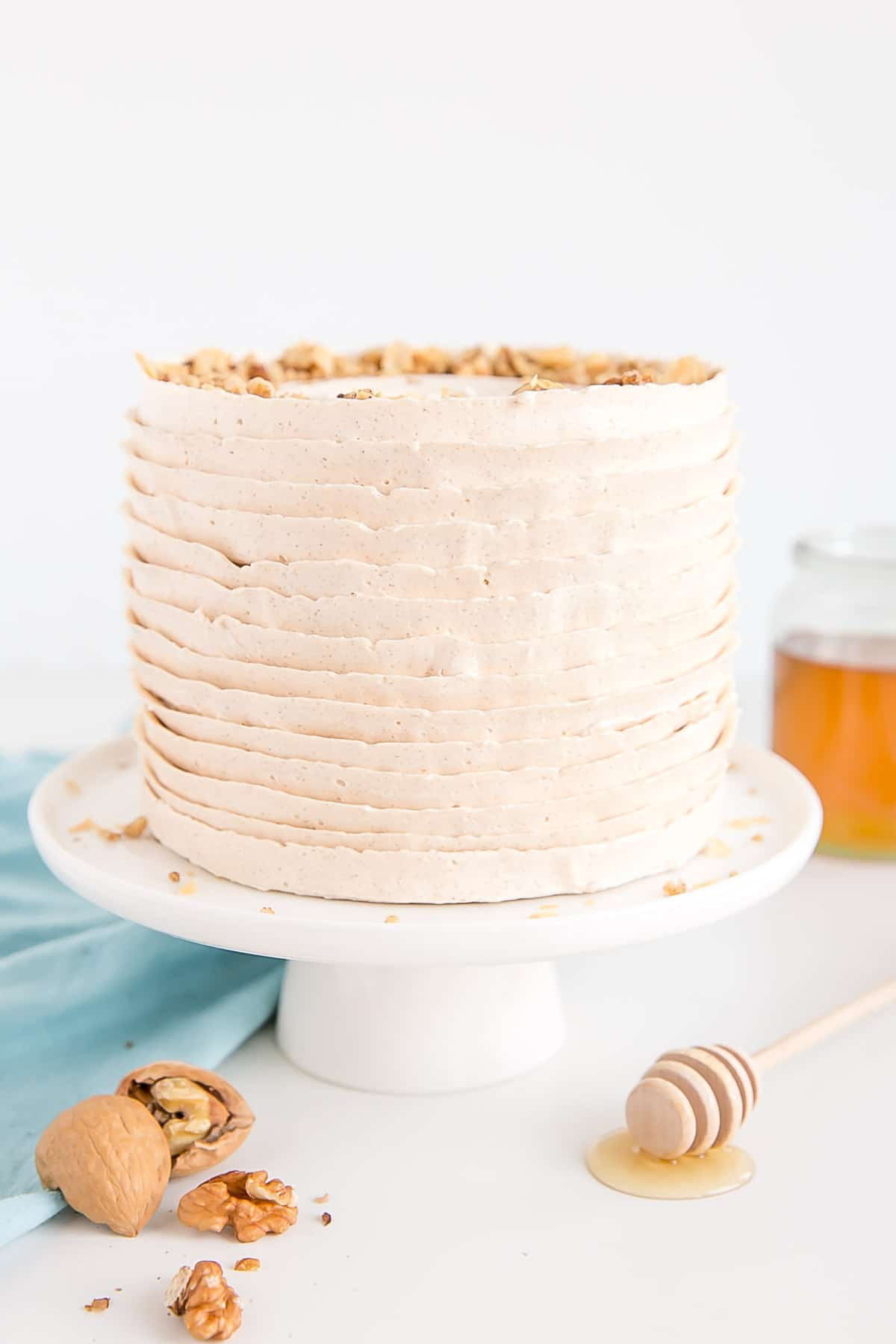 A baklava cake with layers of honey cinnamon frosting.