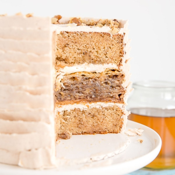 Baklava Cake! A sticky sweet baklava sandwiched between two delicious honey walnut cake layers covered with honey cinnamon buttercream. | livforcake.com