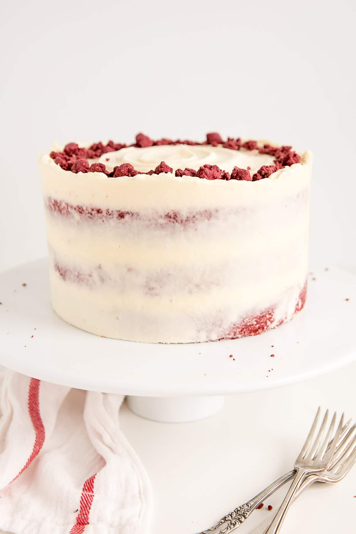 Red velvet cake recipe with cream cheese frosting and red velvet crumble.