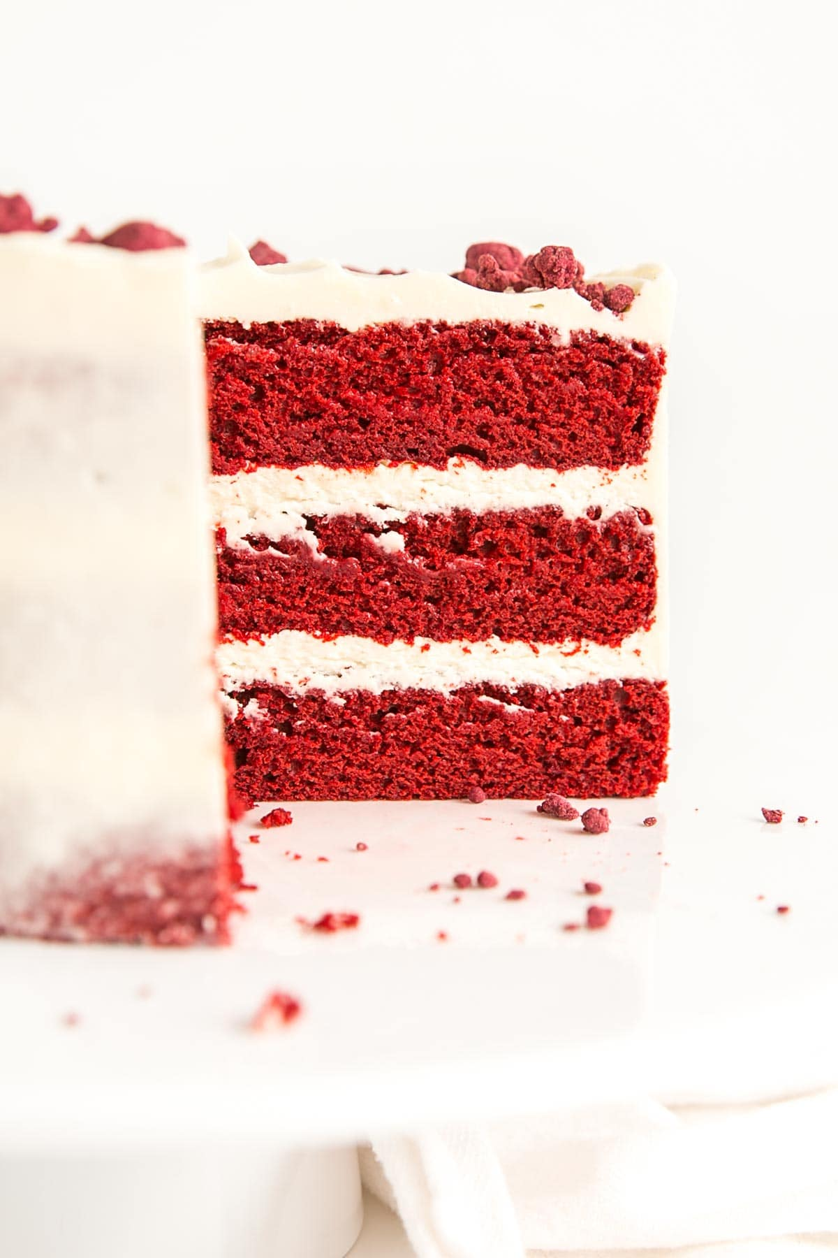 Cross section of cake showing three red velvet layers.