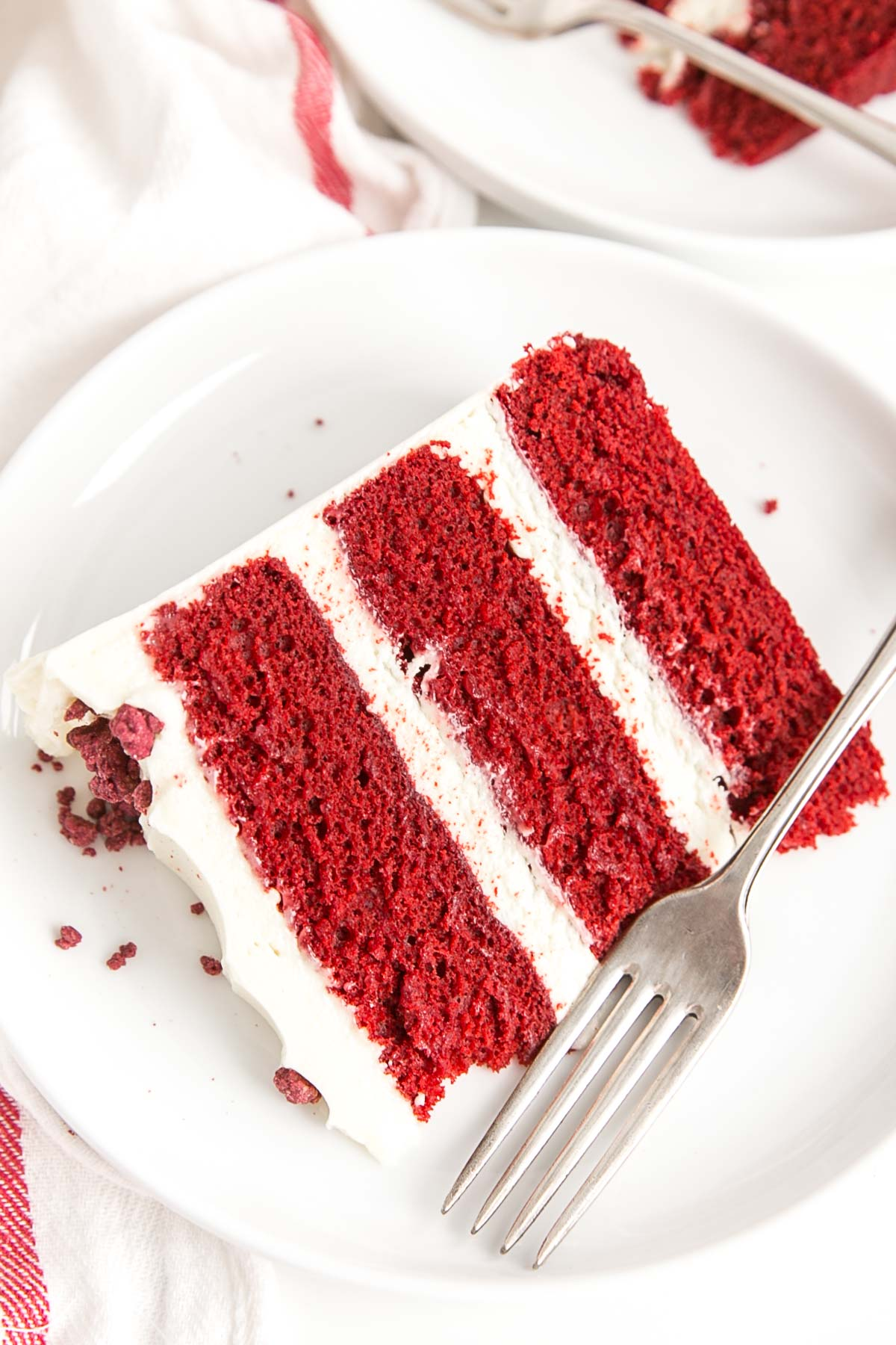 Slice of red velvet cake on a plate.
