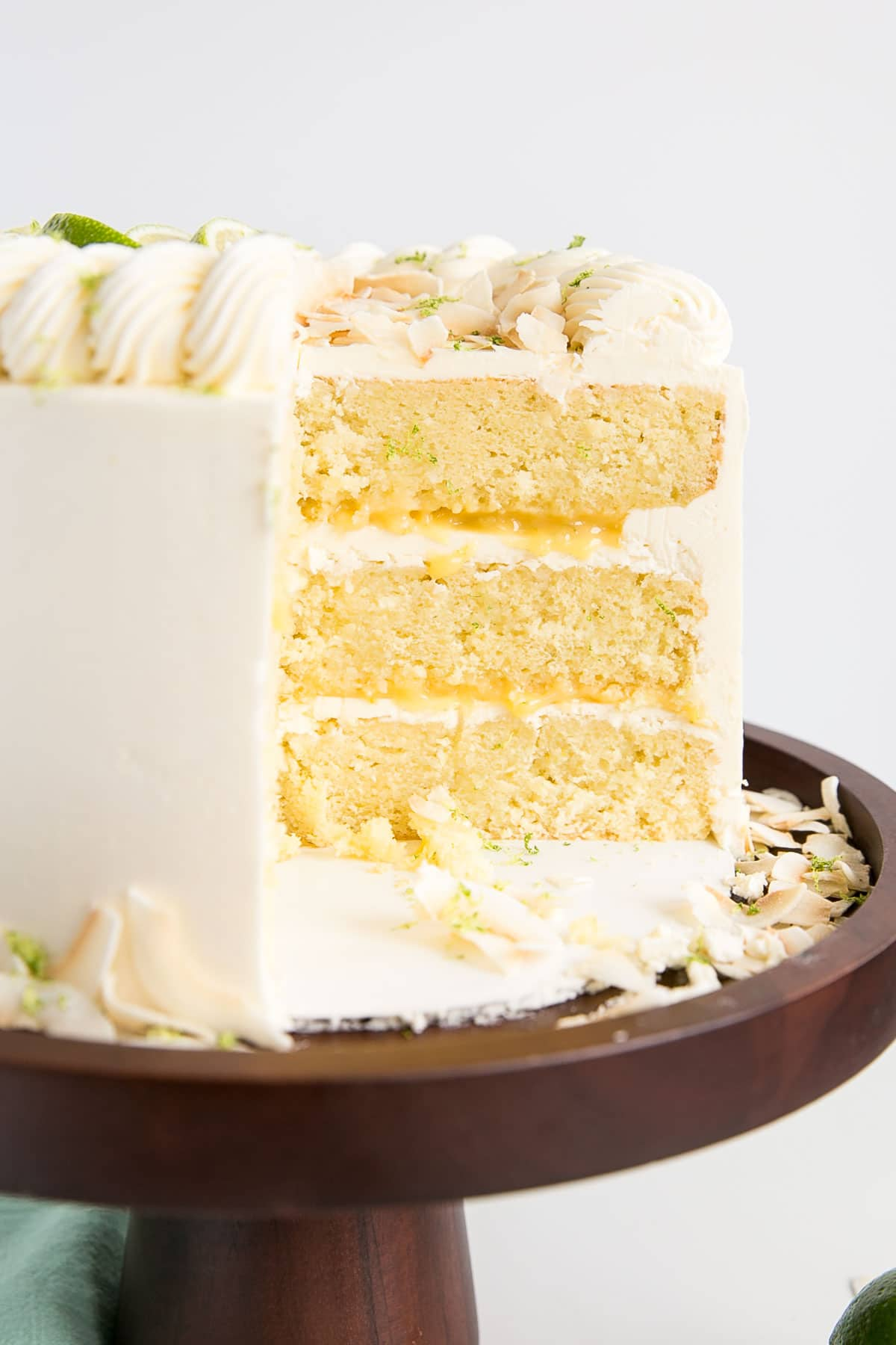 Three-layer coconut lime cake with homemade lime curd and silky coconut buttercream.