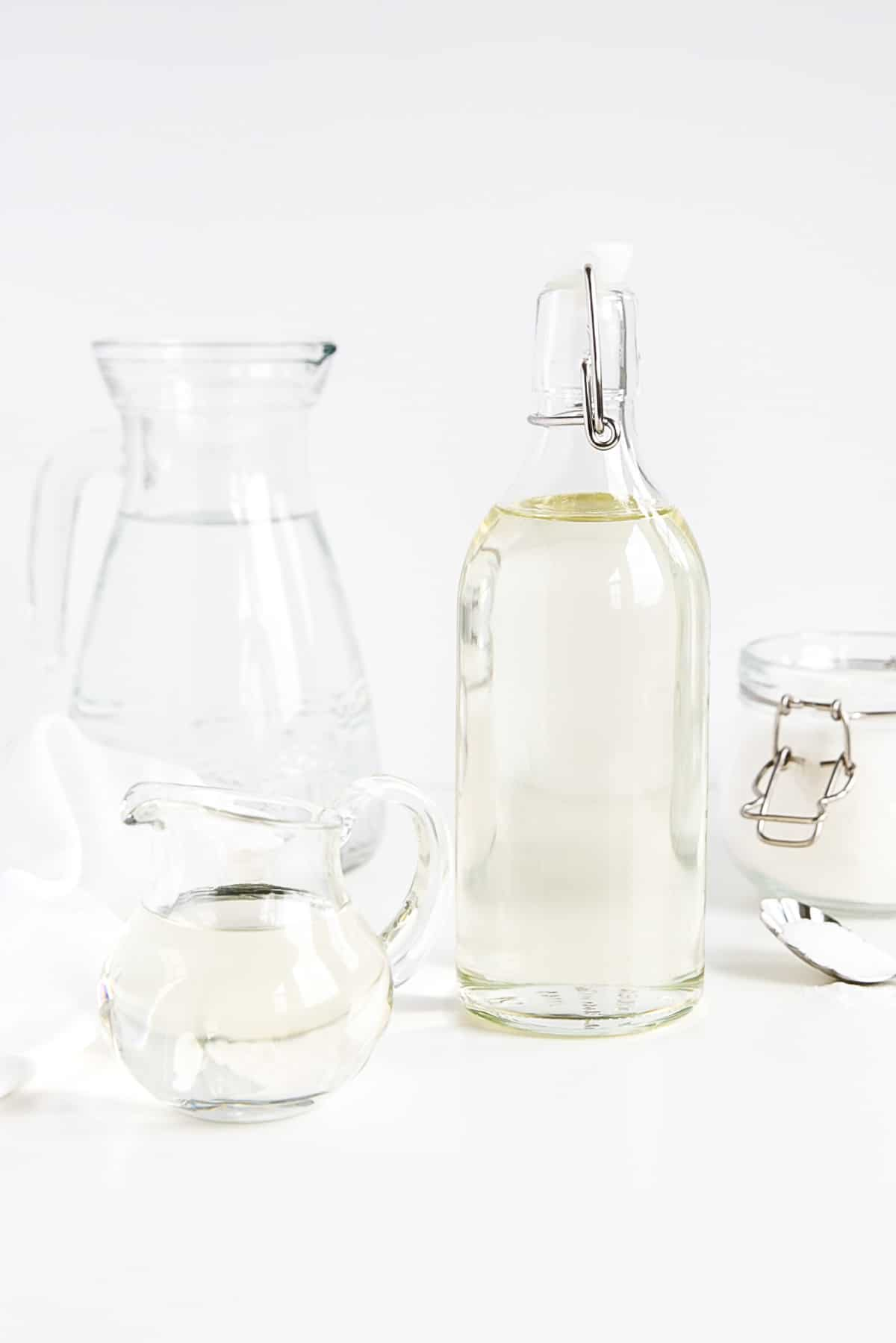 Simple syrup in a bottle shown with water and sugar.