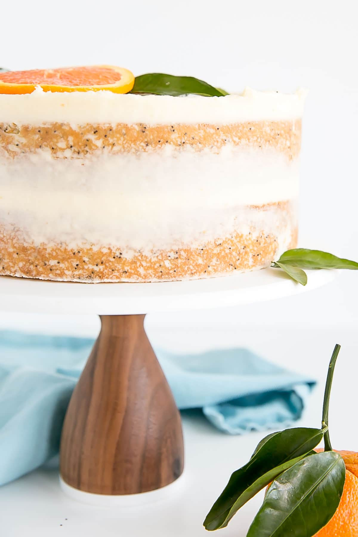 Close up of side of orange poppy seed cake layers