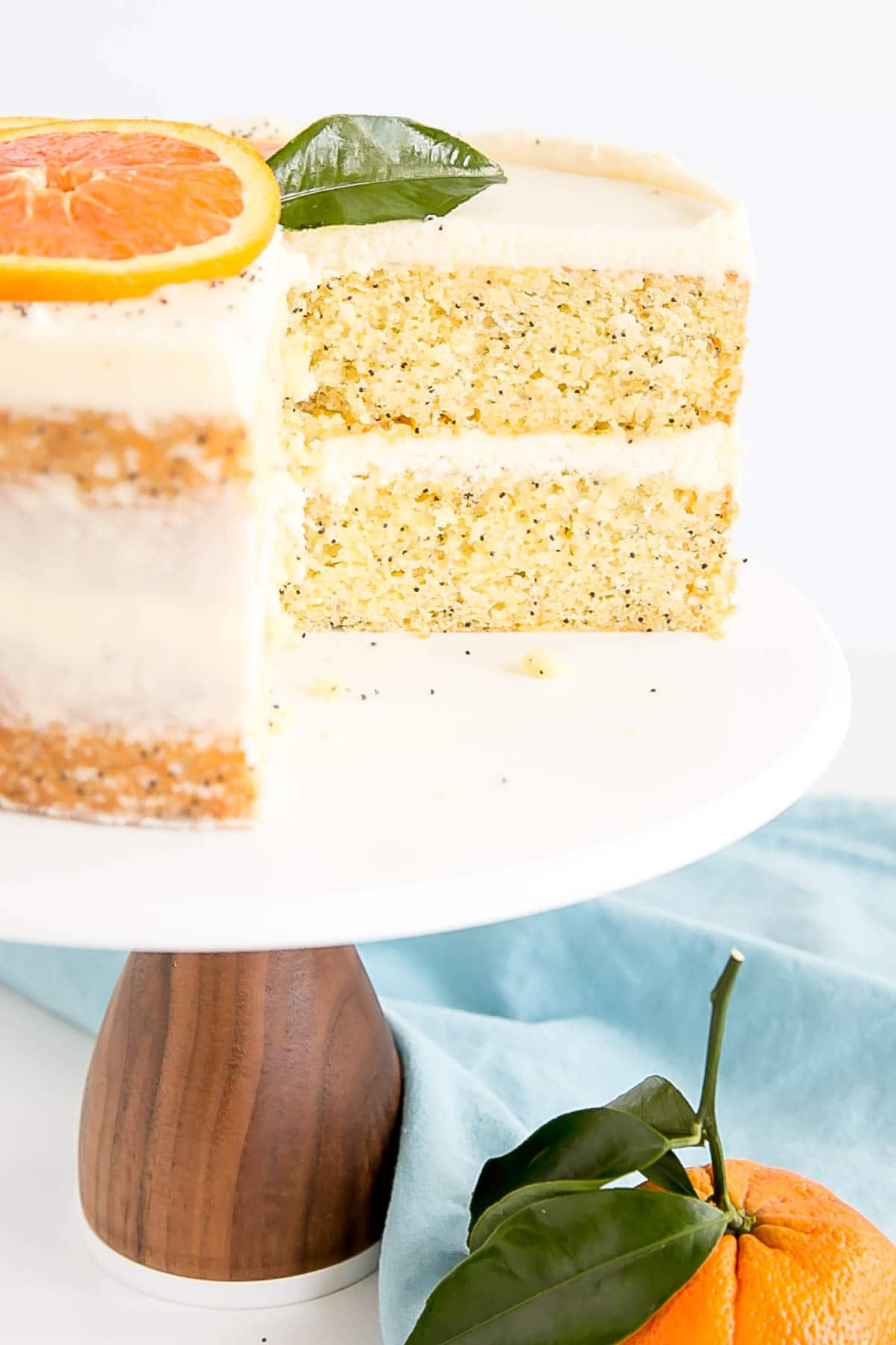 Two orange poppy seed cake layers covered in a delicious mascarpone frosting.