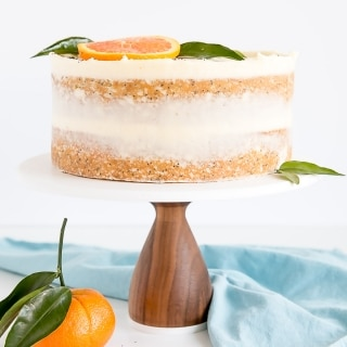 Tender Orange Poppy Seed Cake layers with a delicious mascarpone frosting. | livforcake.com
