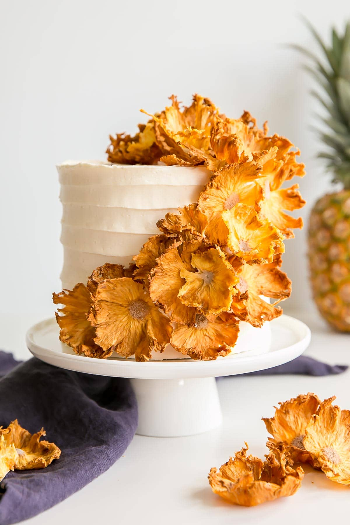 Pineapple cake with pineapple buttercream covered with dehydrated pineapple flowers.