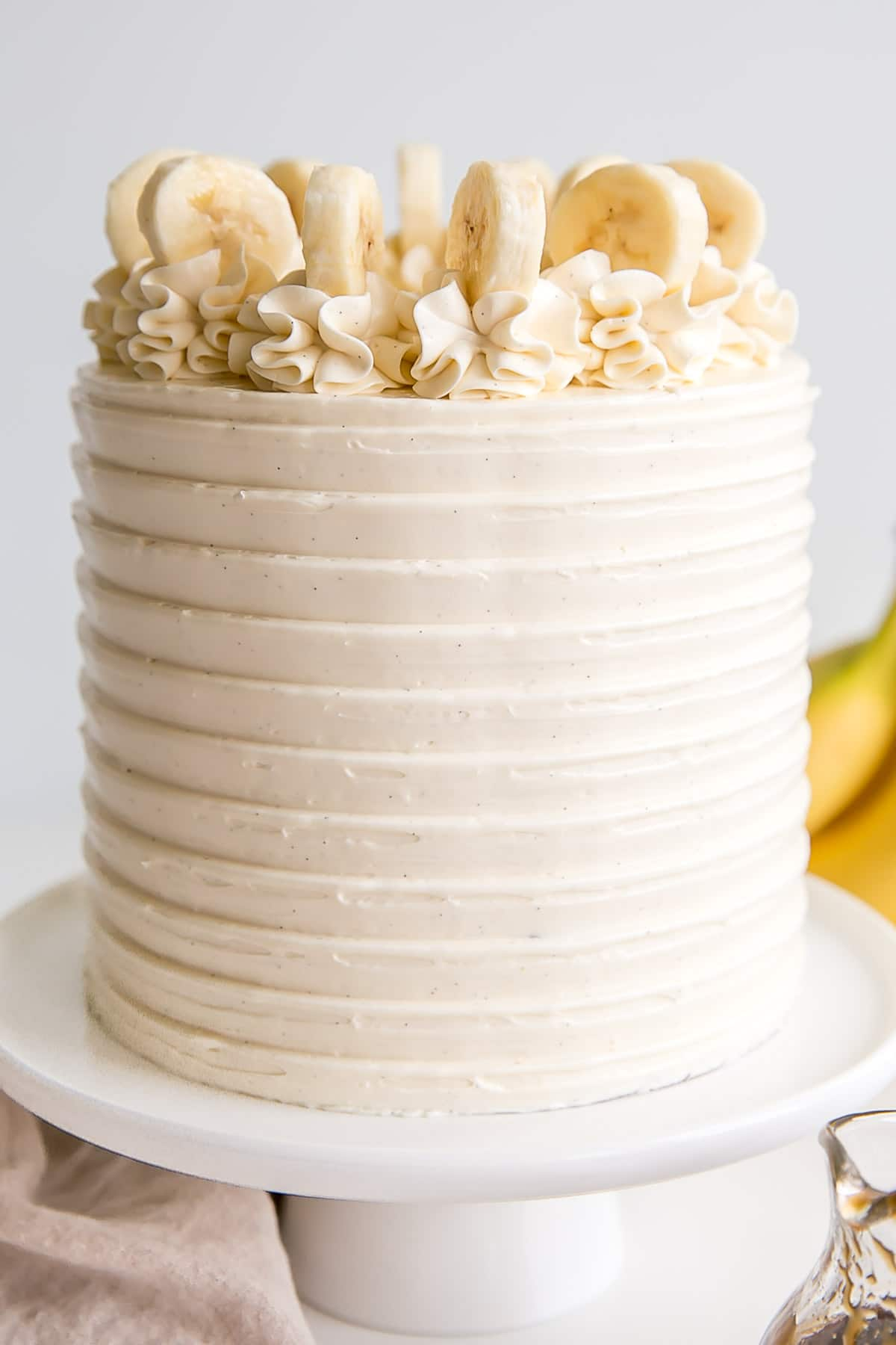 Close up of the front of the cake showing the texture from the cake comb and flecks of vanilla bean.