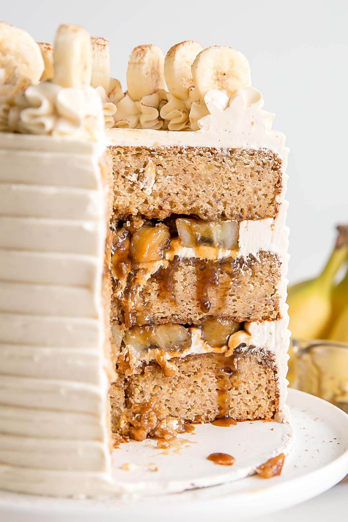 Cross section of a bananas foster cake with banana filling and fosters sauce.