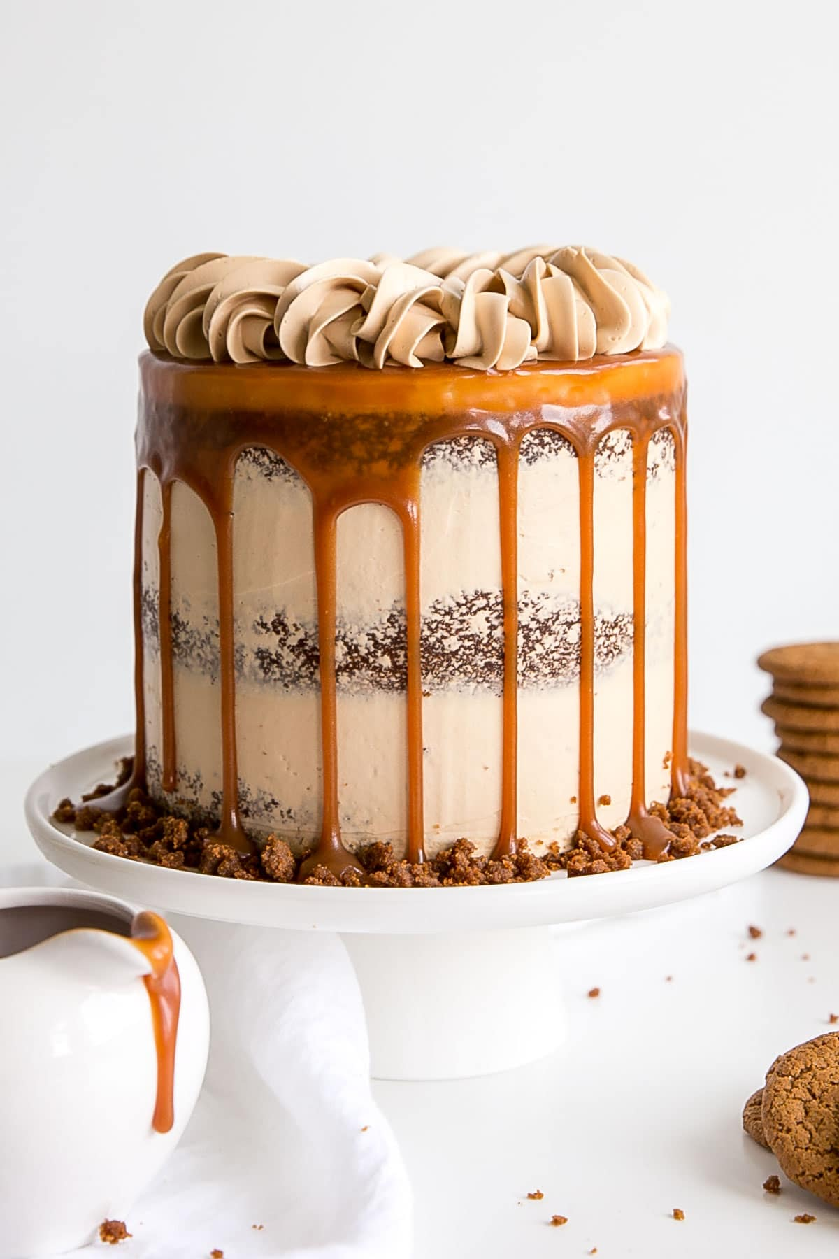 Gingerbread cake with caramel buttercream decorated naked cake style with a caramel drip.