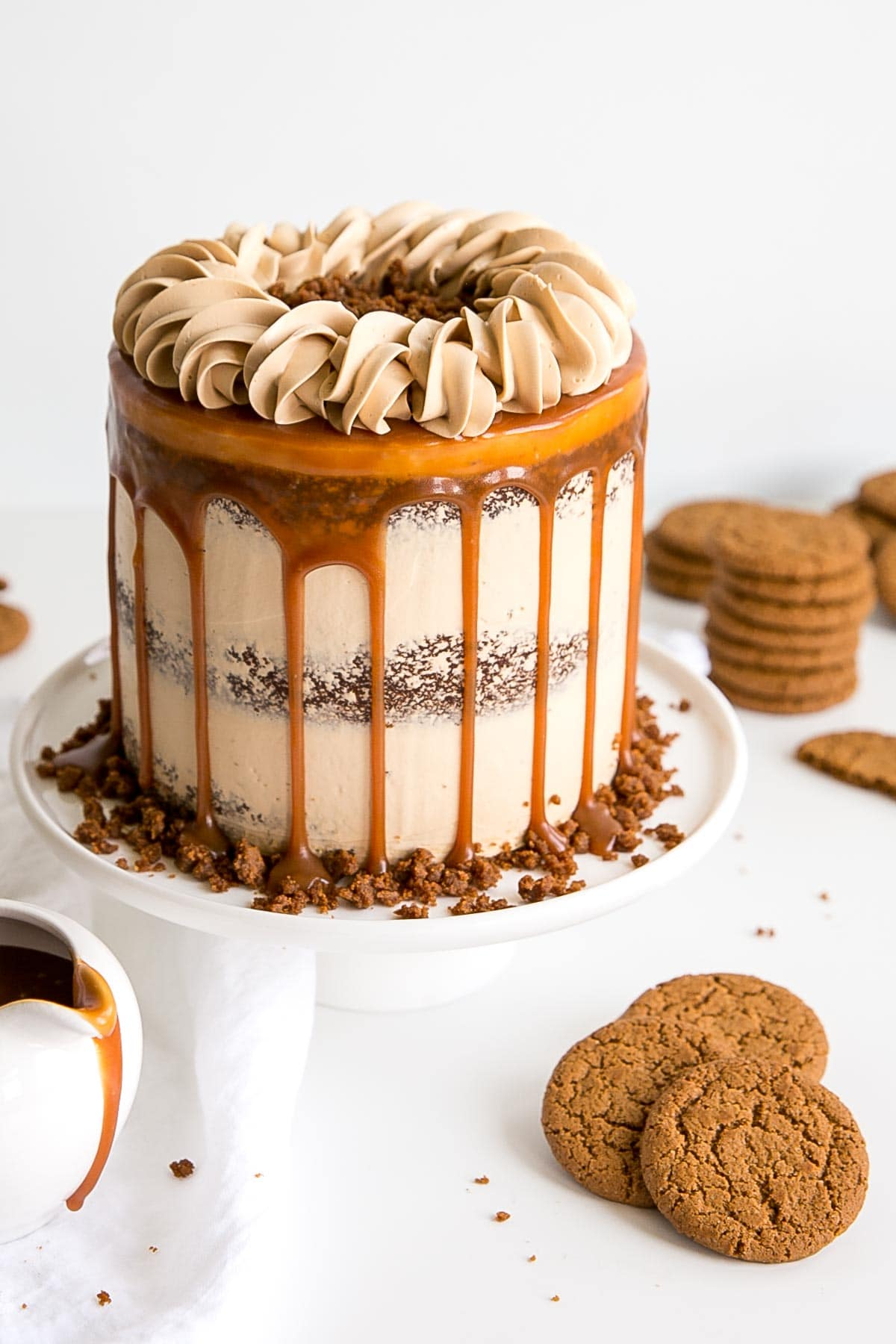 Caramel Gingerbread Cake decorated naked cake style with a caramel drip and rope border on top.